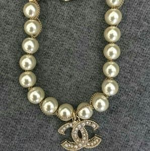 CHANEL Jewelry - Chanel Classic CC Gold Tone Crystal Pearl Bracelet